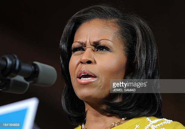 US First Lady Michelle Obama speaks during a campaign rally at Ohio Wesleyan University in Delaware Ohio on October 15 2012 Three weeks before...