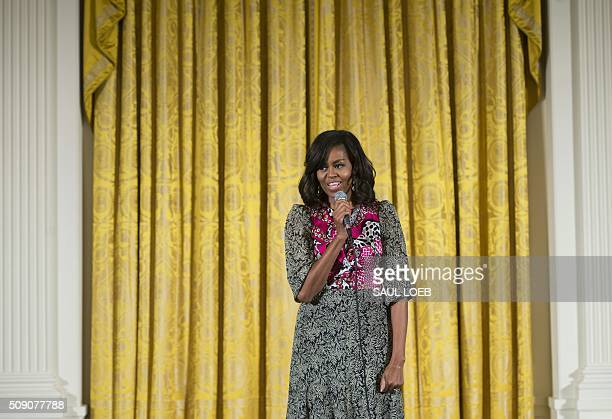 US First Lady Michelle Obama speaks during a daylong dance workshop to highlight contributions African American women have made to dance as part of...