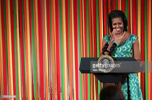 S first lady Michelle Obama speaks during a Kids' State Dinner luncheon at the East Room of the White House August 20 2012 in Washington DC Fiftyfour...