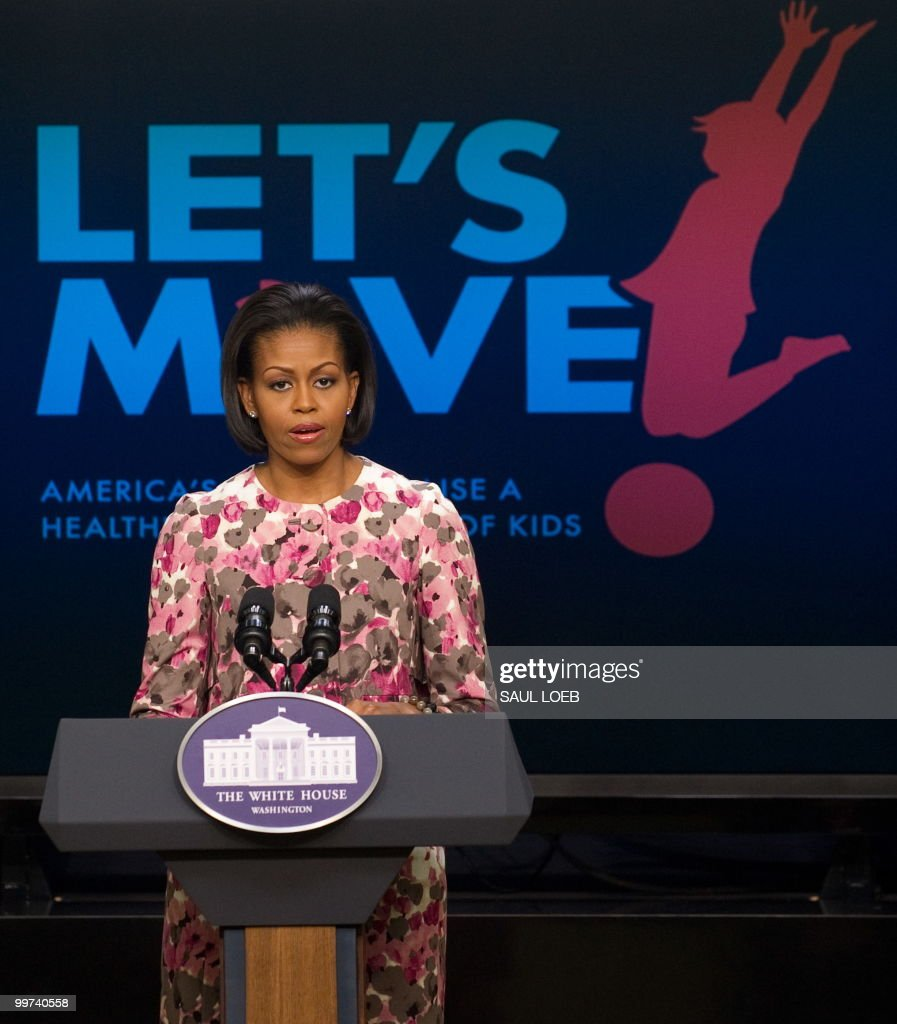 US First Lady Michelle Obama speaks during an event related to Obama's Let's Move! Campaign during an event in the Eisenhower Executive Office Building adjacent to the White House in Washington, DC, May 17, 2010. Obama announced that the Partnership for a Healthier America has reached an agreement with Healthy Weight Commitment Foundation members to reduce product calories by 1.5 trillion by the end of 2015, and 1 trillion by 2012. AFP PHOTO / Saul LOEB