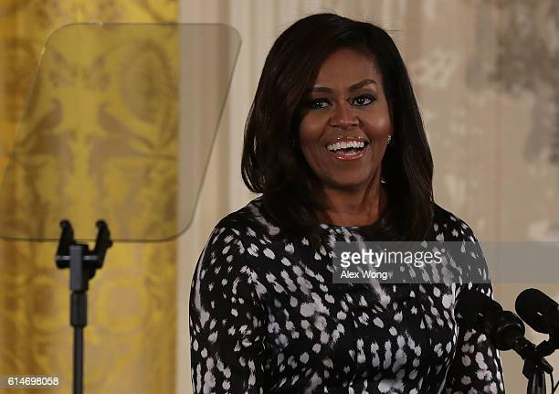 S First Lady Michelle Obama speaks during an event to celebrate 20th Century Art in the White House October 14 2016 in Washington DC The first lady...