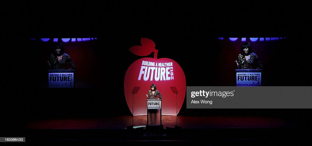 U.S. first lady Michelle Obama speaks during the 'Building a Healthier Future Summit' March 8, 2013 at the Lisner Auditorium of George Washington University in Washington, DC. The first lady spoke on ensuring the health of the nation's youths and childhood obesity.