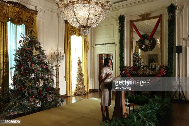 S first lady Michelle Obama speaks in the East Room during a preview of the 2012 White House holiday decorations November 28 2012 at the White House...