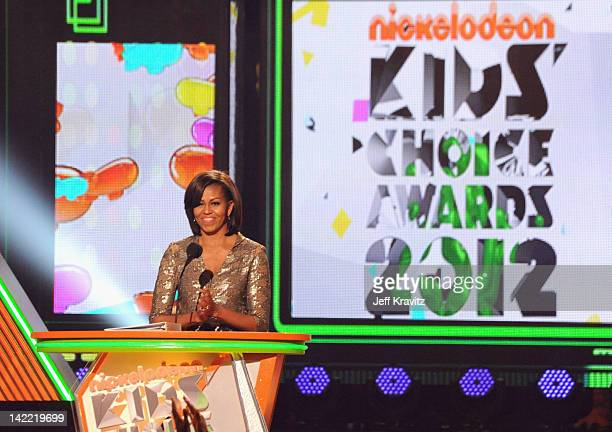 First Lady Michelle Obama speaks onstage at the 2012 Nickelodeon's Kids' Choice Awards at Galen Center on March 31 2012 in Los Angeles California