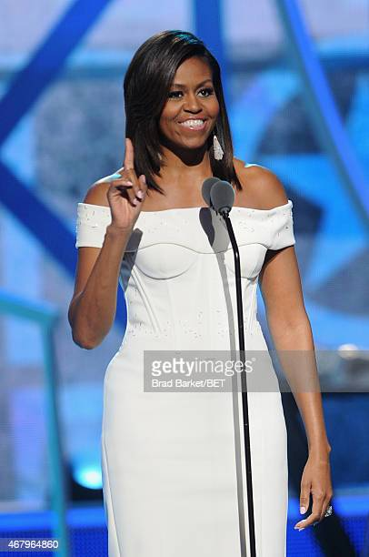 """First Lady Michelle Obama speaks onstage during the """"Black Girls Rock!"""" BET Special at NJPAC – Prudential Hall on March 28, 2015 in Newark, New..."""