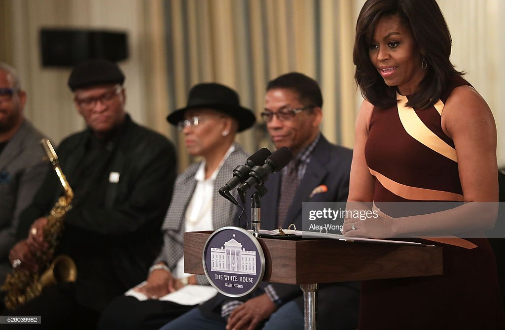 U.S. First Lady Michelle Obama speaks to high school students as musicians Herbie Hancock, Dee Dee Bridgewater and Bobby Watson listen during a History of Jazz Student Workshop at the State Dining Room of the White House April 29, 2016 in Washington, DC. President Barack Obama and the first lady will host a jazz concert this evening on the South Lawn of the White House to celebrate the International Jazz Day.