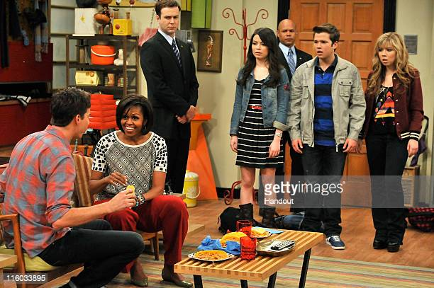 First Lady Michelle Obama speaks to Jerry Trainor whilst she makes a special appearance on Nickelodeon's hit series iCarly at Nick On Sunset studio...