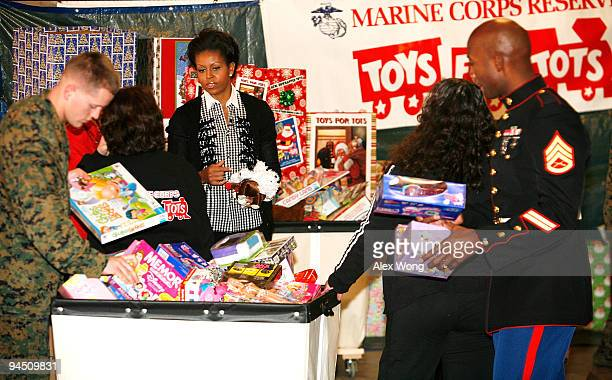 S first lady Michelle Obama speaks to volunteers as she delivers toy donations collected by White House Executive Office staff to the Marine Toys for...