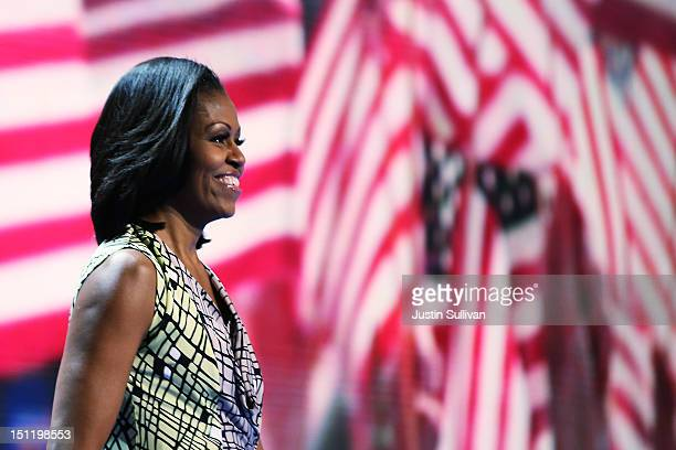 First lady Michelle Obama stands during a soundcheck during preparations for the Democratic National Convention at Time Warner Cable Arena on...