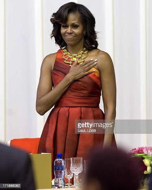US First Lady Michelle Obama stands during the US National Anthem at an official dinner at the Presidential Guest House in Pretoria South Africa on...