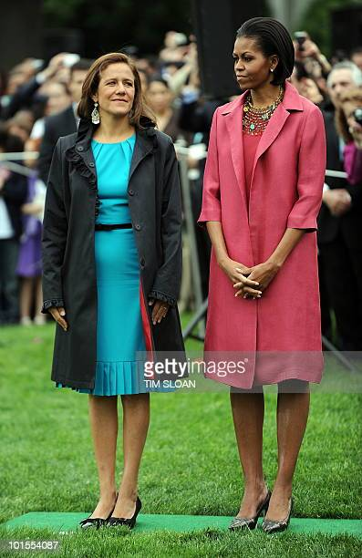 US First Lady Michelle Obama stands with Margarita Zavala during the State Arrival ceremony for Mexican President Felipe Calderón on the South...