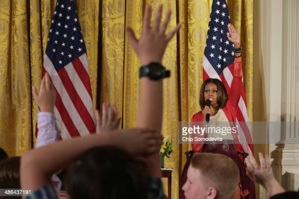 S first lady Michelle Obama takes questions from Executive Office employees' children during an event to mark the White House's annual Take Our...