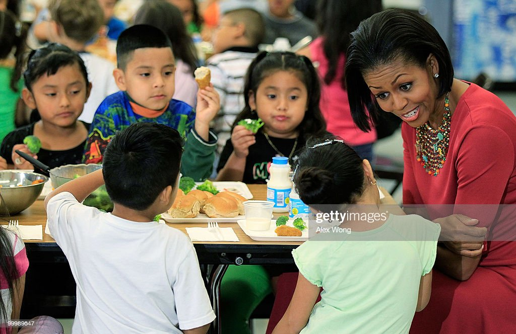 U.S. first lady Michelle Obama (R) talks to Head Start students during lunch as she visits New Hampshire Estates Elementary School May 19, 2010 in Silver Spring, Maryland. The school was awarded the USDA�s Healthier US School Challenge Silver Award in 2009 and partnered with a school in Mexico as part of the Monarch Butterfly Sister School Program. President of Mexico Felipe Calderon is on a state visit to Washington with the first lady of Mexico.