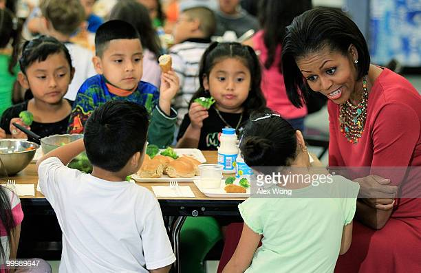S first lady Michelle Obama talks to Head Start students during lunch as she visits New Hampshire Estates Elementary School May 19 2010 in Silver...