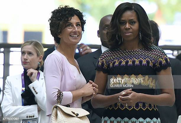US First Lady Michelle Obama talks with Agnese Landini wife of Italian Prime Minister Matteo Renzi as she arrives to the World Expo in Milan on June...