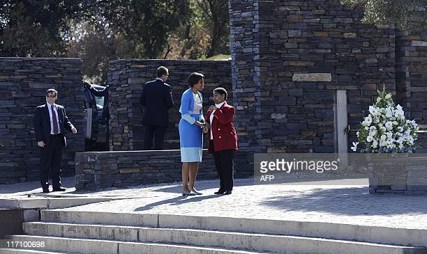 US First Lady Michelle Obama talks with Antoinette Sithole sister of Hector Pieterson a 12yearold boy killed during the student uprising in protest...