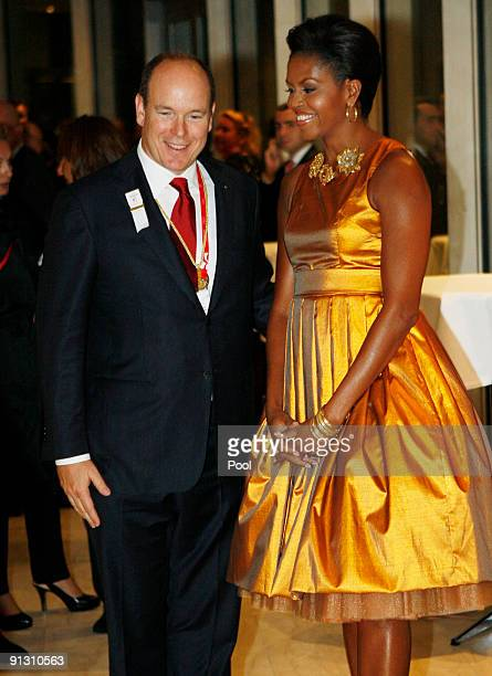 S first lady Michelle Obama talks with Prince Albert of Monaco at a reception following the opening Ceremony of the 121st IOC Session at the...