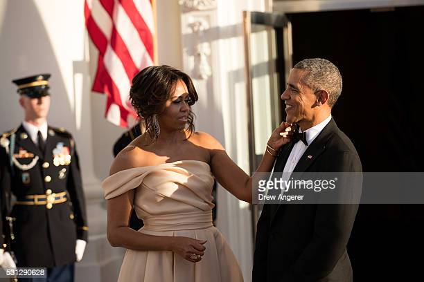 First Lady Michelle Obama touches US President Barack Obama's chin as they wait for leaders to arrive for the Nordic state dinner on the North...