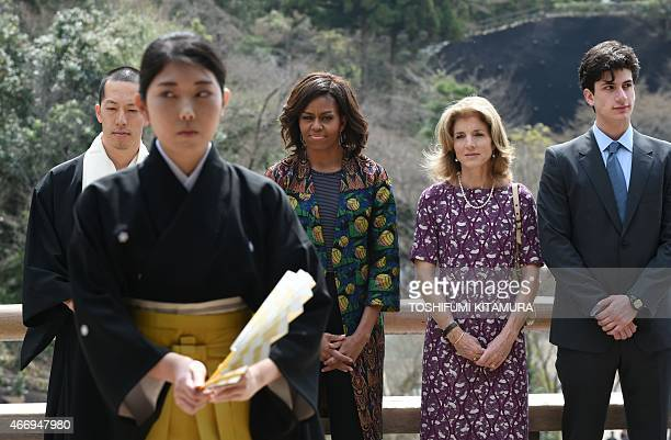 US First Lady Michelle Obama US Ambassador to Japan Caroline Kennedy and her son Jack Schlossberg watch a student perform a Noh play during a visit...