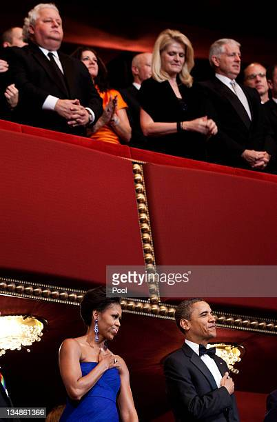 First lady Michelle Obama US President Barack Obama and others listen during the national anthem at the live taping of the annual during Kennedy...