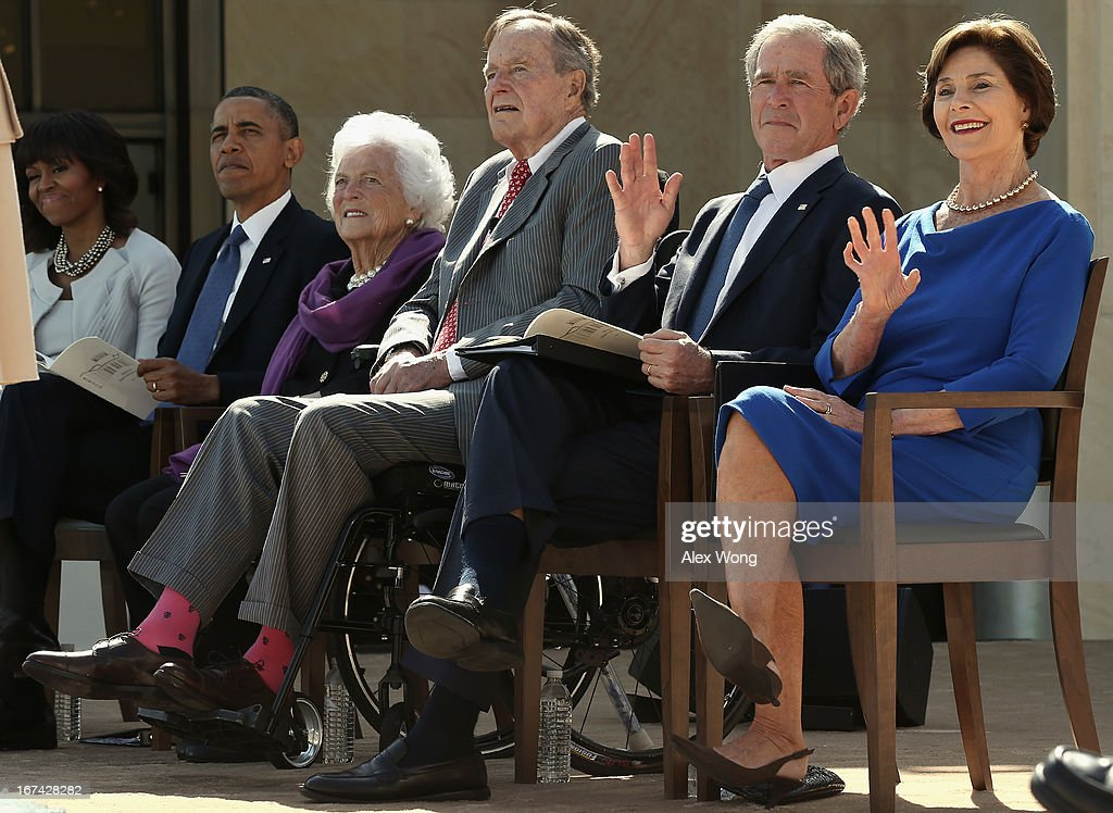 First lady Michelle Obama, U.S. President Barack Obama, former first lady Barbara Bush, former President George H.W. Bush, former President George W. Bush and former first lady Laura Bush attend the opening ceremony of the George W. Bush Presidential Center April 25, 2013 in Dallas, Texas. The Bush library, which is located on the campus of Southern Methodist University, with more than 70 million pages of paper records, 43,000 artifacts, 200 million emails and four million digital photographs, will be opened to the public on May 1, 2013. The library is the 13th presidential library in the National Archives and Records Administration system.