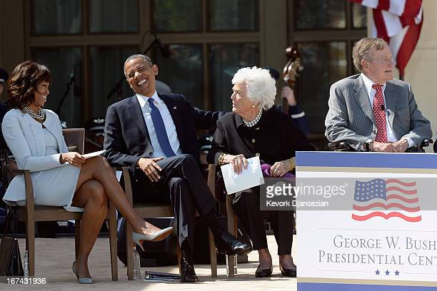First lady Michelle Obama, U.S. President Barack Obama, former first lady Barbara Bush and former President George H.W. Bush attend the opening...