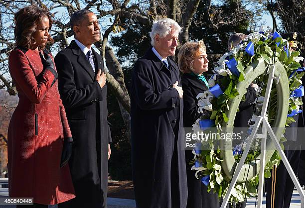 First lady Michelle Obama US President Barack Obama Former US President Bill Clinton and former US Secretary of State Hillary Clinton lay a wreath at...
