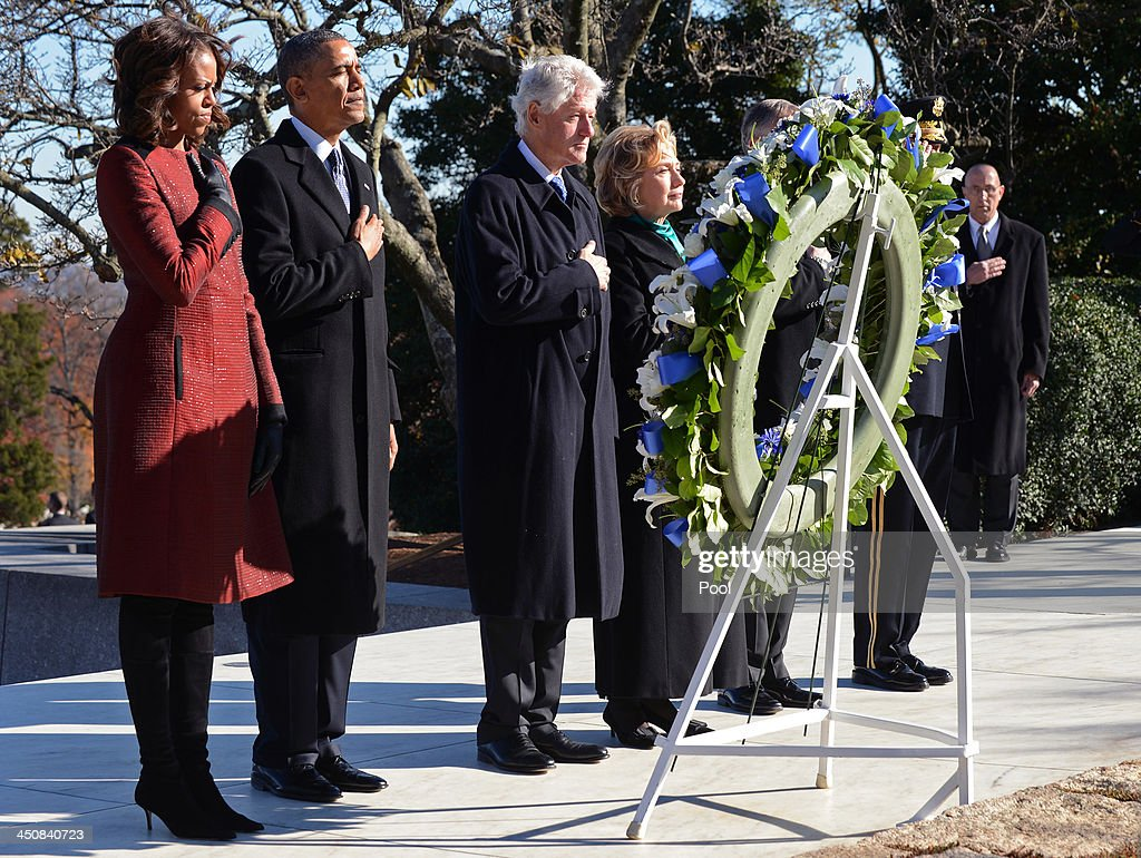 First lady Michelle Obama, U.S. President Barack Obama, Former U.S. President Bill Clinton and former U.S. Secretary of State Hillary Clinton lay a wreath at the grave site for President John F. Kennedy at Arlington National Cemetery November 20, 2013 in Arlington, Virginia. The 50th anniversary of the assassination of John F. Kennedy will be marked on November 22.