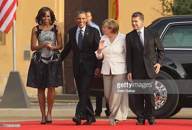 US First Lady Michelle Obama US President Barack Obama German Chancellor Angela Merkel and her husband Joachim Sauer attend the dinner given in...