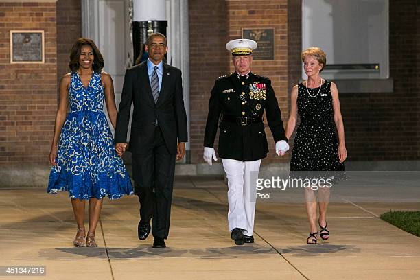 First lady Michelle Obama US President Barack Obama Marine Corps Commandant General James F Amos and his wife Bonnie arrive for the Marine Barracks...