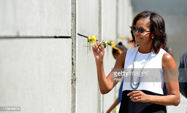 S First Lady Michelle Obama visits Berlin Wall memorial at Bernauer Strasse on June 19 2013 in Berlin Germany Obama is visiting Berlin for the first...