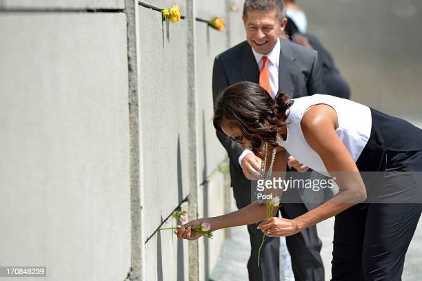 S First Lady Michelle Obama visits Berlin Wall memorial at Bernauer Strasse together with Joachim Sauer the German Chancellor's husband on June 19...