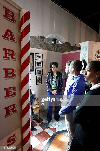 S first lady Michelle Obama visits the District Six museum in Cape Town South Africa on June 23 2011 with hers daughter Malia Obama niece Leslie...