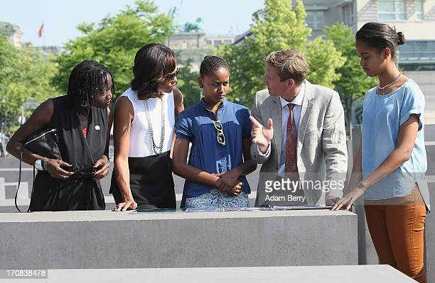 S First Lady Michelle Obama visits the Memorial to the Murdered Jews of Europe with her husband's half sister Auma Obama her daughter Sasha Uwe...