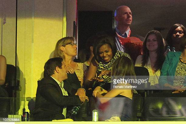 First Lady Michelle Obama visits with fans from a suite during Game Six of the 2010 NBA Finals between the Boston Celtics and the Los Angeles Lakers...