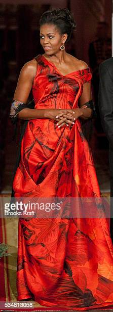 First lady Michelle Obama waits to greet Chinese President Hu Jintao for a state dinner at the White House in Washington Obama wore a deep red gown...