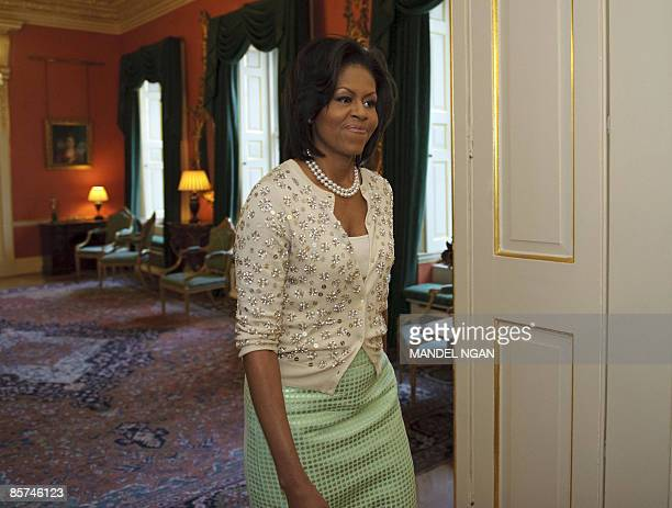 US First Lady Michelle Obama walks into a room to pose for group photo at 10 Downing Street in central London on April 1 2009 Harry Potter author JK...