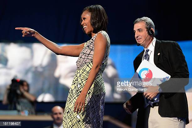 First lady Michelle Obama walks on stage during a soundcheck with stage manager David Cove during preparations for the Democratic National Convention...