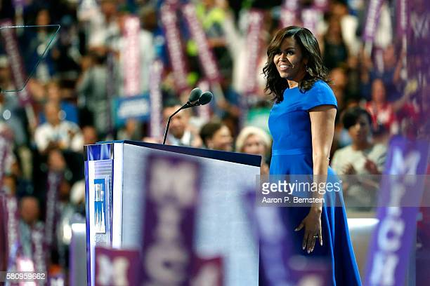 First lady Michelle Obama walks on stage to deliver remarks on the first day of the Democratic National Convention at the Wells Fargo Center July 25...