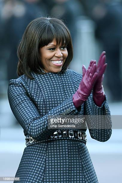 First lady Michelle Obama walks the route as the presidential inaugural parade winds through the nation's capital January 21 2013 in Washington DC...