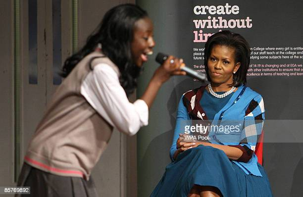 First Lady Michelle Obama watches a concert by pupils during a visit to the Elizabeth Garrett Anderson Secondary School on April 2, 2009 in Borough...