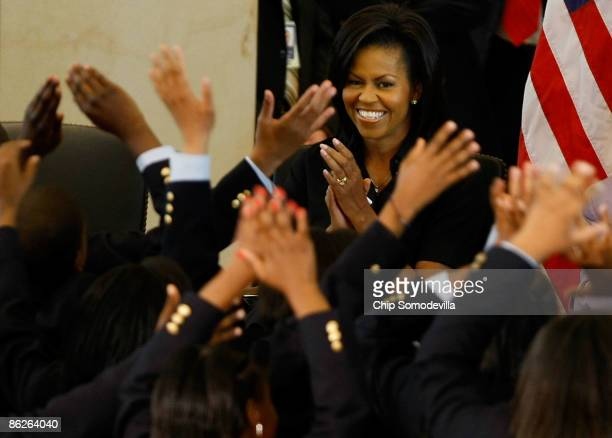 First lady Michelle Obama watches a musical performance during the unveiling ceremony for the bust of Sojourner Truth in the US Capitol Visitors...