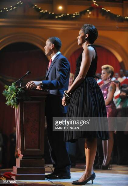 US First Lady Michelle Obama watches as her husband President Barack Obama speaks during the Christmas in Washington Celebration December 13 2009 at...