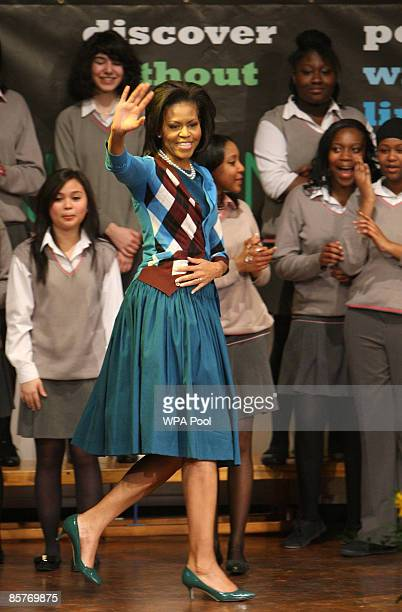 First Lady Michelle Obama waves as she meets students during a visit to the Elizabeth Garrett Anderson Secondary School on April 2, 2009 in Borough...