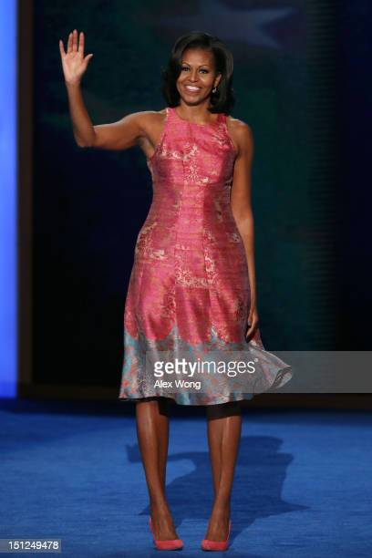 First lady Michelle Obama waves as she takes the stage during day one of the Democratic National Convention at Time Warner Cable Arena on September 4...