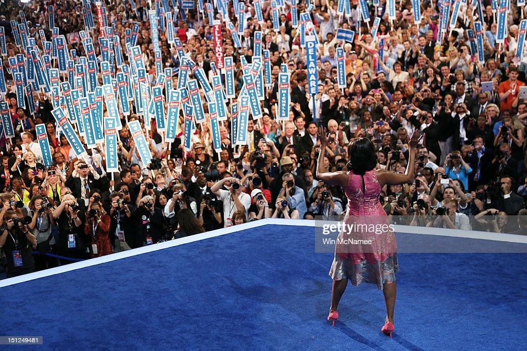 First lady Michelle Obama waves as she takes the stage during day one of the Democratic National Convention at Time Warner Cable Arena on September 4, 2012 in Charlotte, North Carolina. The DNC that will run through September 7, will nominate U.S. President Barack Obama as the Democratic presidential candidate.