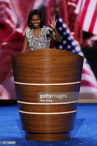First lady Michelle Obama waves at the podium during a soundcheck during preparations for the Democratic National Convention at Time Warner Cable...