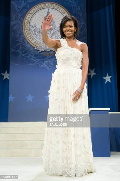 First Lady Michelle Obama waves at the Southern Regional Inaugural Ball at the DC Armory in Washington, DC, early January 20, 2009. AFP PHOTO / Saul...