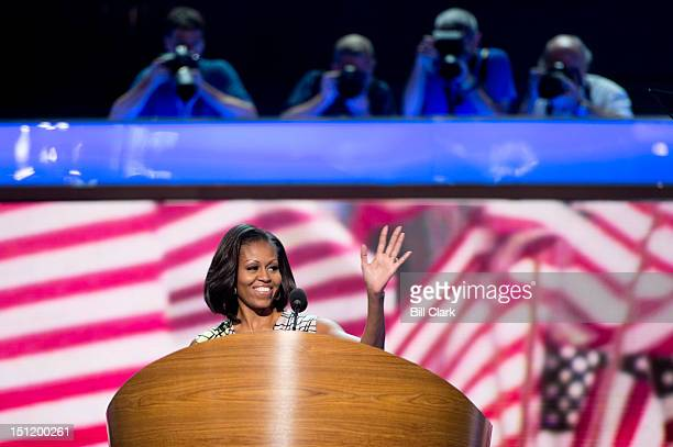 First lady Michelle Obama waves from the stage during her stage walk through for the Democratic National Convention at theTime Warner Cable Arena...