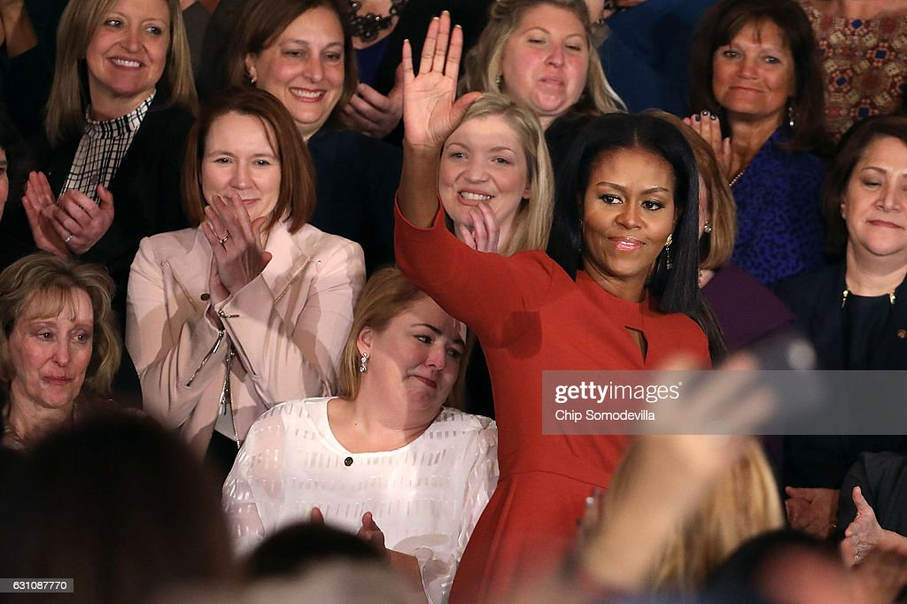 U.S. first lady Michelle Obama waves goodbye after delivering remarks honoring the 2017 School Counselor of the Year and counselors from across the country in the East Room of the White House January 6, 2017 in Washington, DC. These were the last public remarks by the first lady during her husband Barack Obama's presidency.